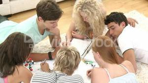 A group of teenagers studying