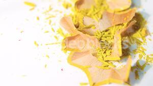 Yellow color pencils shavings on a white background