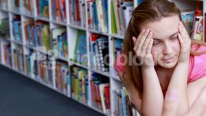 Teacher scolding student in library