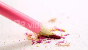 Pink broken colored pencil on white background