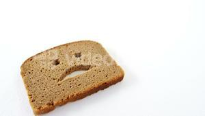 Sad face on bread slice