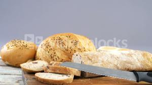 Various bread loaves with knife