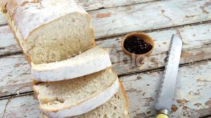 Slices of bread with jam and knife