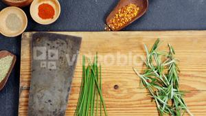 Various spices, chopping board and cleaver