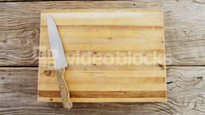 Kitchen knife on wooden chopping board