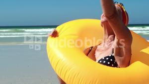 Senior woman with swim ring at the beach