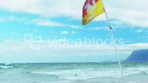Red and yellow safety flag at the beach