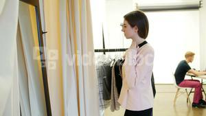 Female model trying apparel during photo shoot